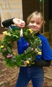 Girl holding handmade Christmas wreath